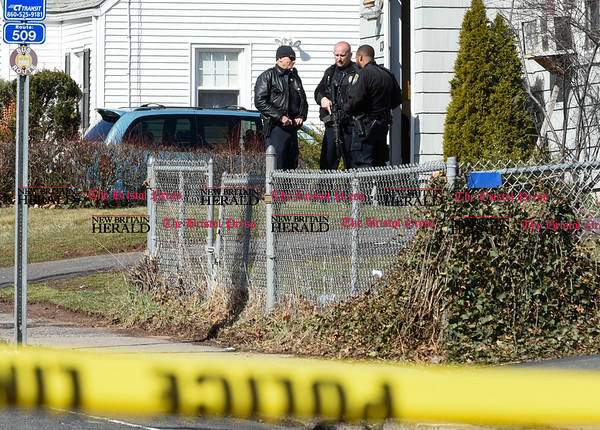 032917 Wesley Bunnell | Staff New Britain Police Officers stand outside of a home on Newington Ave on Wednesday following the shootings of three people earlier that morning.