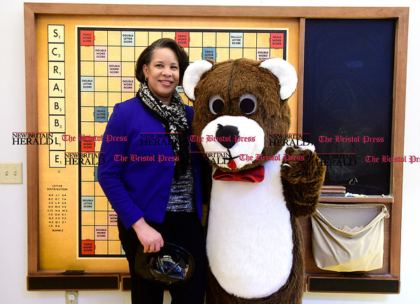 3/11/2017 Mike Orazzi | Staff Thomaston Savings Bank's Phyllis Tucker with a giant teddy bear during the Imagine Nation Museum Early Learning Center's Teddy Bear Clinic held on Saturday morning in Bristol.