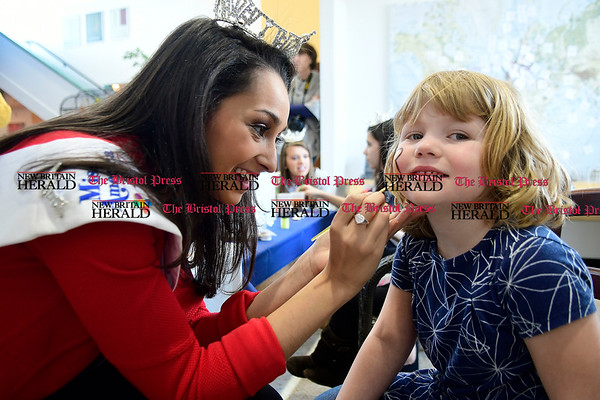 3/11/2017 Mike Orazzi | Staff Miss Bristol Gina Salvatore paints Hailey Lane's face during the Imagine Nation Museum Early Learning Center's Teddy Bear Clinic held on Saturday morning in Bristol.