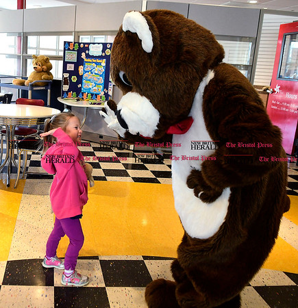 3/11/2017 Mike Orazzi | Staff Lucy Castonguay with a giant teddy bear during the Imagine Nation Museum Early Learning Center's Teddy Bear Clinic held on Saturday morning in Bristol.