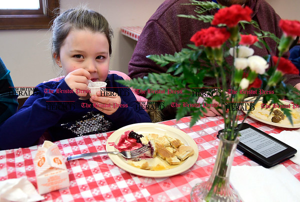 3/11/2017 Mike Orazzi | Staff Kathryn wall during an all you can eat pancake breakfast and maple sugaring event organized by the New Britain Youth Museum Saturday morning in Berlin.