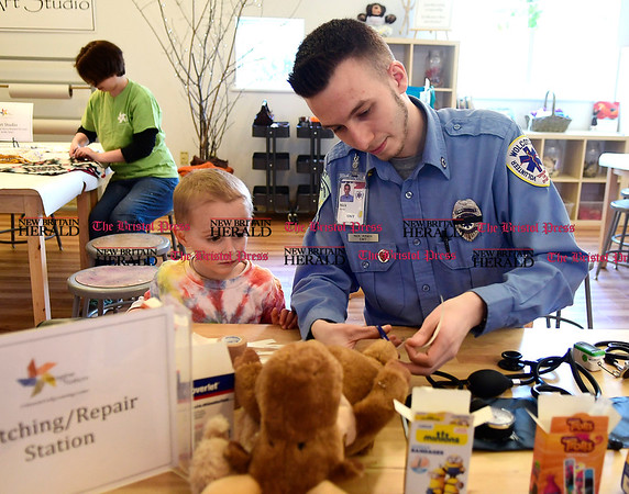 3/11/2017 Mike Orazzi | Staff Wolcott Ambulance EMT Nick Amato works on Maximo Harrison's stuffed moose Moose during the Imagine Nation Museum Early Learning Center's Teddy Bear Clinic held on Saturday morning in Bristol.