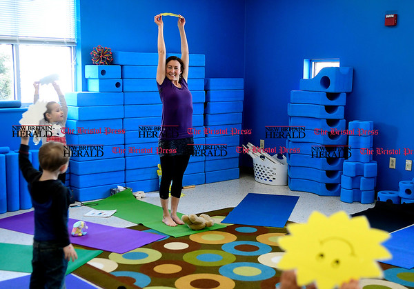 3/11/2017 Mike Orazzi | Staff Yoga instructor Heather Tartarelli during the Imagine Nation Museum Early Learning Center's Teddy Bear Clinic held on Saturday morning in Bristol.