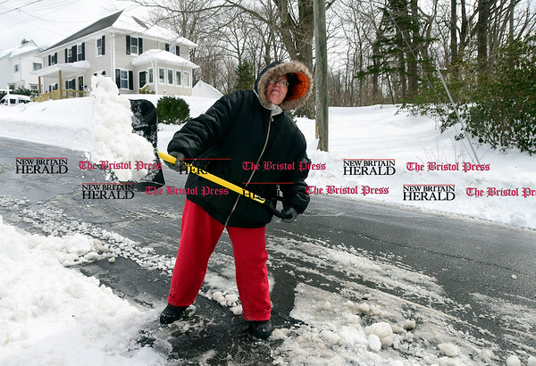 3/15/2017 Mike Orazzi   Staff Lisa Jonaitis while digging out on Mills Street in Bristol after Tuesday's snow fall.