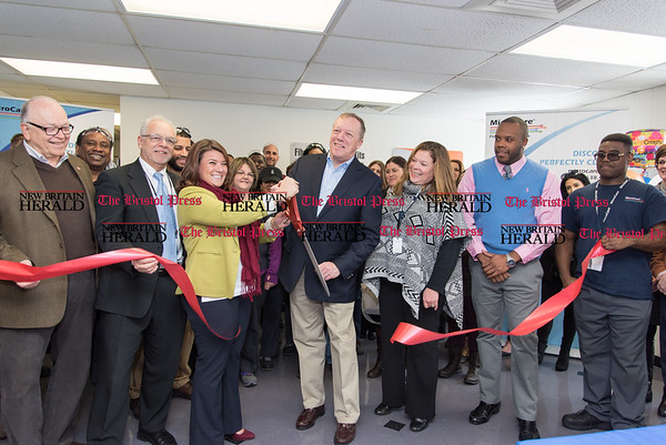 031517 Wesley Bunnell | Staff MicroCare Corp held a ribbon cutting on Wed March 15 to mark the opening of a 15,000 square foot expansion. From the left is Alderman Dom Naples, Economic Development Director Bill Carroll, Mayor Erin Stewart, MicroCare Senior Vice President Jay S. Tourigny, MicroCare V.P. of Business Operations Heather Gombos and Alderman Tremell Collins.