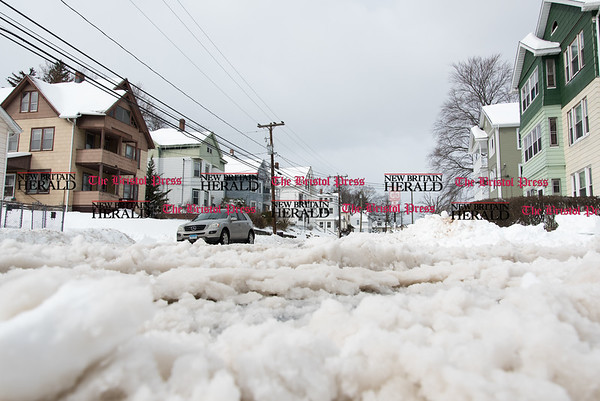 031517 Wesley Bunnell   Staff Many of the roads including the intersection of Day and East St in New Britain were covered in slushy snow making driving difficult the day after heavy snow on Wednesday March 15.