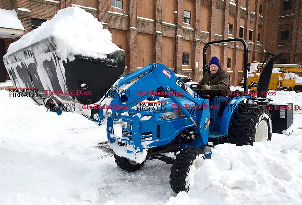 3/15/2017 Mike Orazzi | Staff Bills Allread digs out Wednesday with his LS G3038 tractor on South Main Street in Terryville after Tuesday's snow fall.