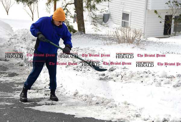 3/15/2017 Mike Orazzi | Staff Mike Drozdick shovels a combination of ice and snow from his driveway on Crescent Street in Terryville after Tuesday's snow fall.