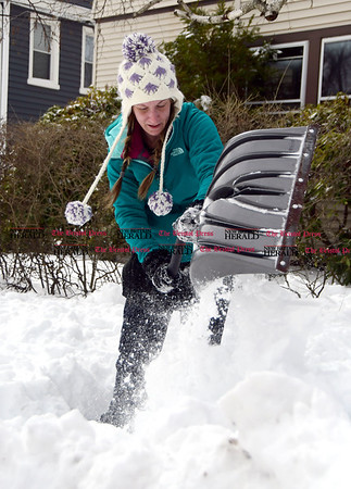 3/15/2017 Mike Orazzi | Staff Erika Perry shovels out her sidewalk on Goodwin Drive in Bristol while cleaning up from the latest snowfall Wednesday.