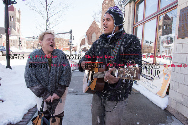 031717 Wesley Bunnell | Staff Domonique Esquire shown busking with help from Jill Friedman on Main St in New Britain on March 17, 2017.