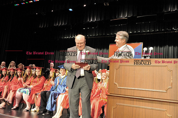 Rob Heyl Retiring Principal George Synnott recieves a Berlin High Diploma from the President of the Board of Education Gary Brochu warning that it isn't valid untill you sign it. 06.20.10 for 06.21.10