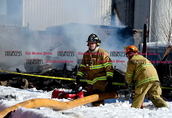 3/17/2017 Mike Orazzi | Staff Terryville Volunteer Firefighters back on scene of a fire at the former OZ Gedney factory on Route 72 in Pequabuck section of Plymouth Friday afternoon after some hot spots started burning again.