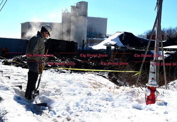 3/17/2017 Mike Orazzi | Staff Town of Plymouth Deputy Fire Marshall Charlie Doback on scene of fire at the former OZ Gedney factory on Route 72 in Pequabuck section of Plymouth Friday morning.