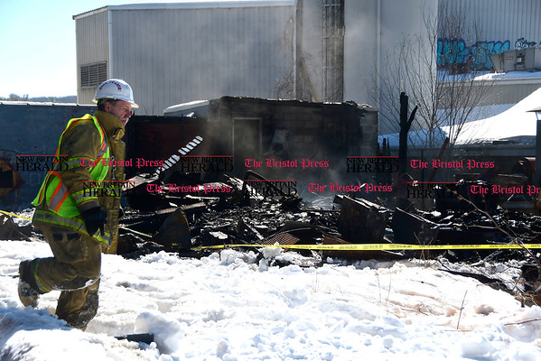3/17/2017 Mike Orazzi | Staff Town of Plymouth Fire Marshall and Assistant Fire Chief Raymond Kovaleski on scene of fire at the former OZ Gedney factory on Route 72 in Pequabuck section of Plymouth Friday morning.