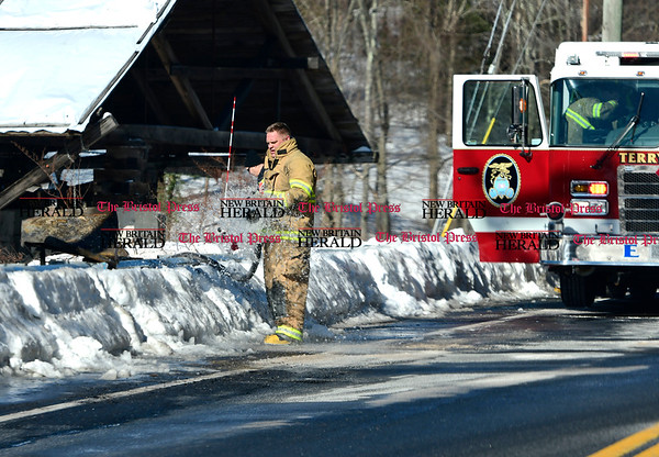 3/17/2017 Mike Orazzi | Staff Terryville Volunteer Fire fighters on scene of fire at the former OZ Gedney factory on Route 72 in Pequabuck section of Plymouth Friday morning.