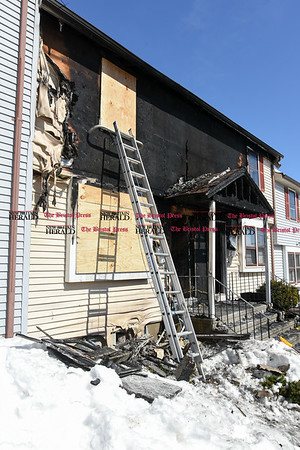 031717 Wesley Bunnell | Staff Fire gutted 220 Lasalle St. unit B6 on the left and damaged the neighboring unit B5 early in the morning on March 17, 2017.