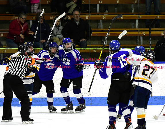 3/18/2017 Mike Orazzi | Staff Hall-Southington's Jacob Mohr (19) (right) celebrates a goal during the CIAC 2017 State Boys Ice Hockey Tournament Division III Finals at Ingalls Rink in New Haven Saturday.