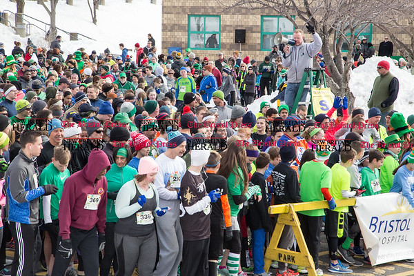 Patrick Collins, at top right, gives final instructions to the runners and walkers just before the start of the two mile course of the Shamrock Run in Bristol, Mar. 18, 2017. Runners braved the below freezing temperatures to participate in the 15th year of the event. (Photo by Christopher Zajac)