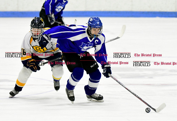 3/18/2017 Mike Orazzi | Staff Woodstock Academy's Avery Riva (16) and Hall-Southington's Jeremy Fortin (3) during the CIAC 2017 State Boys Ice Hockey Tournament Division III Finals at Ingalls Rink in New Haven Saturday.