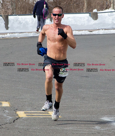 It wasn't too cold for Bruce Christensen of Bolton to take off his shirt before the finish line of the five mile course of the Shamrock Run in Bristol, March 18, 2017. (Photo by Christopher Zajac)
