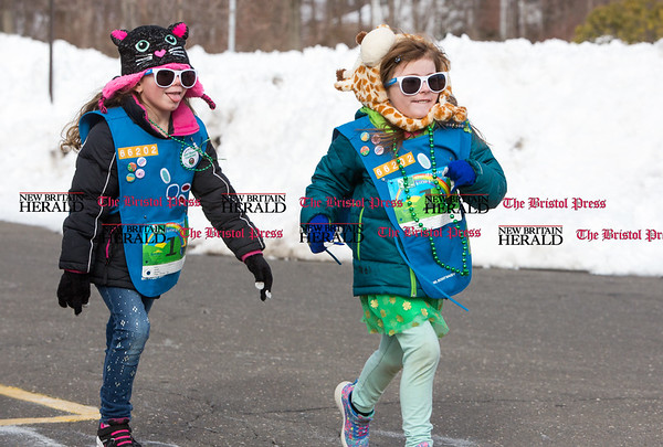 Ava Hancock, right, and Danika LeBlanc, both Girl Scout Daisies from Bristol, run together in the kids fun run at the Shamrock Run in Bristol on March 18, 2017. (Photo by Christopher Zajac)