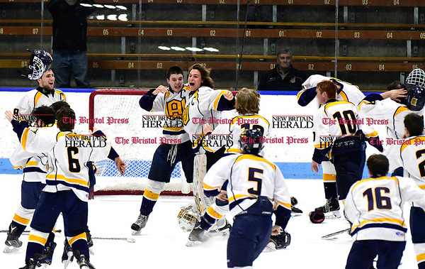 3/18/2017 Mike Orazzi | Staff Woodstock Academy celebrates a win over Hall-Southington during the CIAC 2017 State Boys Ice Hockey Tournament Division III Finals at Ingalls Rink in New Haven Saturday.