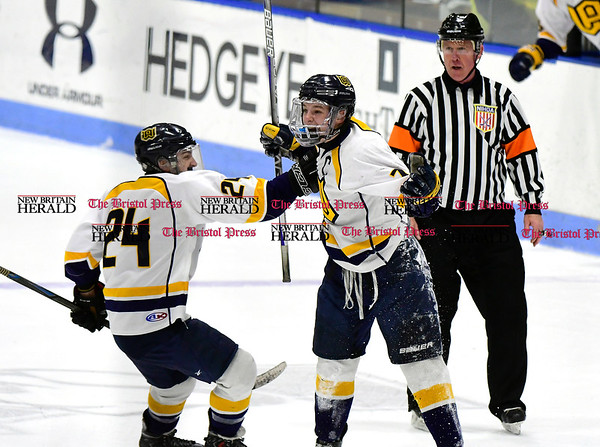 3/18/2017 Mike Orazzi | Staff Woodstock Academy's Ryan Black (7) while celebrating a goalie during the CIAC 2017 State Boys Ice Hockey Tournament Division III Finals at Ingalls Rink in New Haven Saturday.