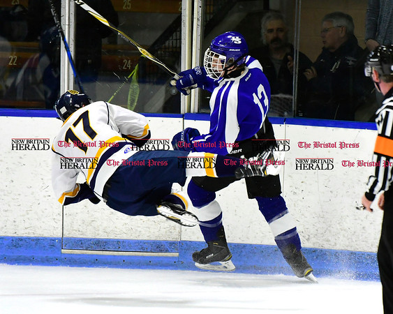 3/18/2017 Mike Orazzi | Staff Woodstock Academy's Gunner Moore (17) and Hall-Southington's Nathalan Zmarlicki (13) during the CIAC 2017 State Boys Ice Hockey Tournament Division III Finals at Ingalls Rink in New Haven Saturday.