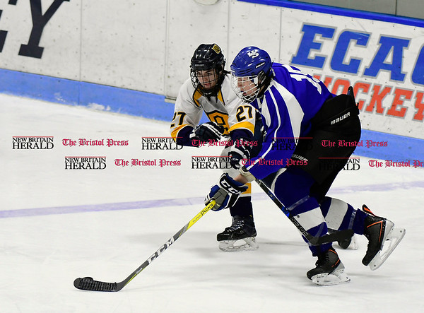 3/18/2017 Mike Orazzi | Staff Woodstock Academy's Ryan Wojciechowski (27) and Hall-Southington's Richard Mitchell IV (15) during the CIAC 2017 State Boys Ice Hockey Tournament Division III Finals at Ingalls Rink in New Haven Saturday.