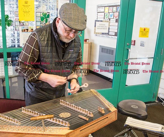 Craig Stalk, of West Hartford, plays traditional Irish music on the hammer dulcimer in the lobby of Chippens Hill Middle School before the start of the 15th Annual Shamrock Run in Bristol, March 18, 2017. Stalk has performed at every Shamrock Run. (Photo by Christopher Zajac)
