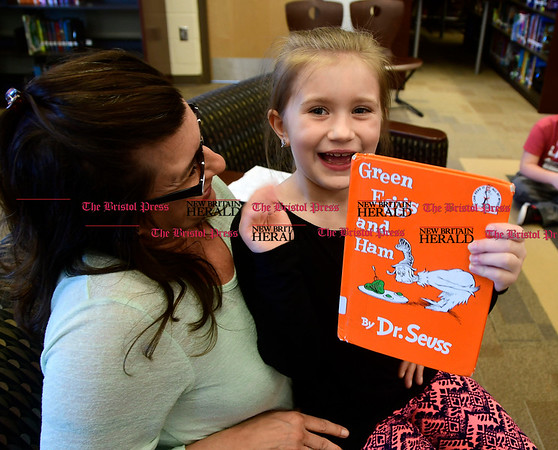 3/2/2017 Mike Orazzi | Staff West Bristol School's Haley Pilon reads to 4th and 5th grade students during &quote;Read Across America Day&quote; in Bristol Thursday. Sitting with her is her mom and hero Jen.