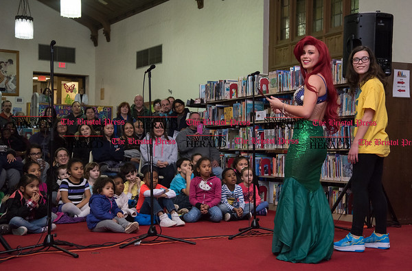 030217 Wesley Bunnell | Staff New Britain High School held a rehearsal for their upcoming performances of The Little Mermaid at the New Britain Public Library on Thursday March 2. Jasmine Colapietro plays Ariel along with Leah Gaffney as flounder.
