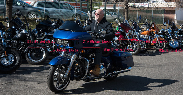 030217 Wesley Bunnell   Staff Salesman Michael Morin of Yankee Harley Davidson in Bristol takes a Road Glide on a test ride on Thursday March 2. The state is currently discussing implementing a mandatory helmet law for all motorcycle riders.