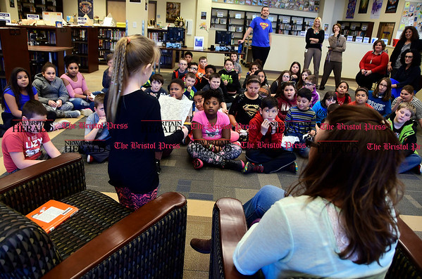3/2/2017 Mike Orazzi | Staff West Bristol School's Haley Pilon reads to 4th and 5th grade students during &quote;Read Across America Day&quote; in Bristol Thursday.