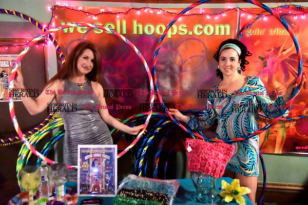 3/25/2017 Mike Orazzi | Staff Mary-Beth Oliver and Vanna Vroom during SWAN DAY CT held at Trinity-on-Main Saturday night in New Britain while selling Hula Hoops.