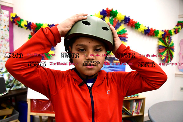 3/25/2017 Mike Orazzi | Staff Freddy Orellana,10, adjusts a new bike helmet he received at the Children's Department the annual safety fair Saturday. Members of the Bristol Elks Lodge 1010 distributed close to 100 helmets to area children for the 9th year.