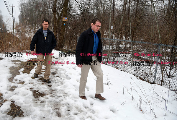 3/28/2017 Mike Orazzi | Staff Plainville Police Detectives Marc Rivard and David Slater at the entrance to the Metacomet hiking trail off Route 6 in Farmington. The search of Rattlesnake Mountain continues from New Britain to Plainville and Farmington in the hopes of finding a 64-year-old hiker who has been missing since Saturday.