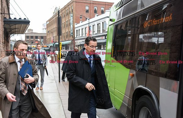 032817 Wesley Bunnell | Staff Governor Dannel Malloy marked the 2nd anniversary of CT Fastrak on March 28, 2017. The governor rode from Union Station in Hartford to Elmwood Station in West Hartford where a ceremony was held at the adjacent 616 New Park which is under construction as a mixed use transit-oriented development project. Governor Malloy is shown boarding at Union Station.