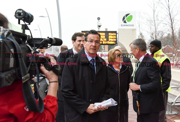 032817 Wesley Bunnell | Staff Governor Dannel Malloy marked the 2nd anniversary of CT Fastrak on March 28, 2017. The governor rode from Union Station in Hartford to Elmwood Station in West Hartford where a ceremony was held at the adjacent 616 New Park which is under construction as a mixed use transit-oriented development project. Governor Malloy arrives at Elmwood Station.