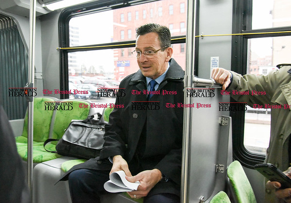 032817 Wesley Bunnell | Staff Governor Dannel Malloy marked the 2nd anniversary of CT Fastrak on March 28, 2017. The governor rode from Union Station in Hartford to Elmwood Station in West Hartford where a ceremony was held at the adjacent 616 New Park which is under construction as a mixed use transit-oriented development project. Governor Malloy just prior to leaving Union Station.