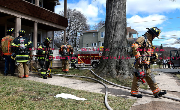 3/29/2017 Mike Orazzi | Staff Members of the Bristol fire department on scene of a house fire on Harrison Street Wednesday afternoon. One person was transported to Bristol Hospital after receiving burns.