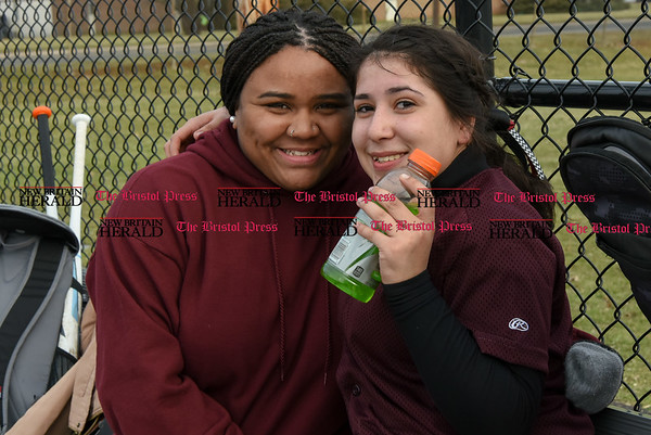 033017 Wesley Bunnell   Staff New Britain High School softball players sit in the dugout during a scrimmage against Cromwell on Thursday afternoon at Chesley Park.