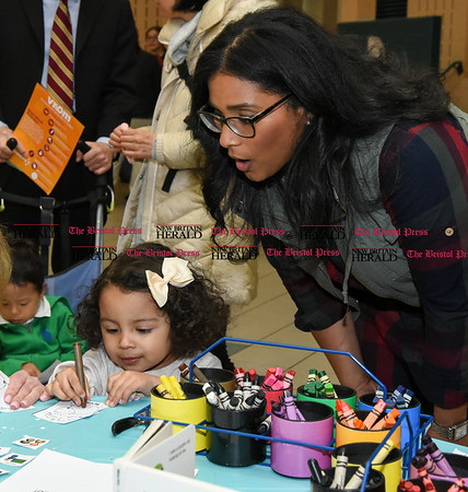 033017 Wesley Bunnell | Staff Parent Learning Night or Curriculum Night was held at Roosevelt Early Learning Center on Thursday night. Teachers set up tables for parents to visit with their children in various subjects to better help parents understand their child's needs at home. Having fun at the language & literacy table are Priscilla Morell, age 2, and mom Marisol Morell.