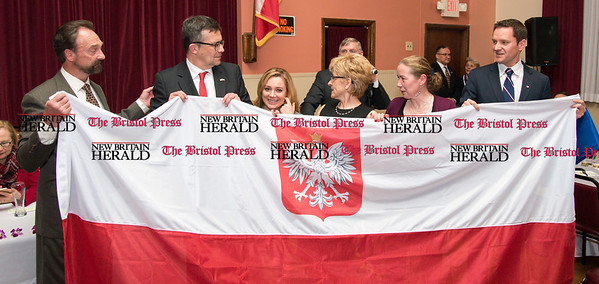 033117 Wesley Bunnell | Staff Polish Ambassador Piotr Wilczek visited New Britain's Little Poland section on Friday March 31, 2017 to celebrate the opening of an honorary Polish Consul in the city. Second from the left is Ambassador Piotr Wilczek, Consul Sabina Klimek & honorary Consul Darek Barcikowski far right.