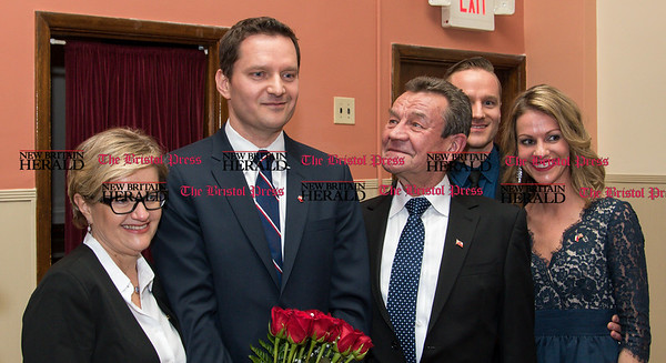 033117 Wesley Bunnell | Staff Polish Ambassador Piotr Wilczek visited New Britain's Little Poland section on Friday March 31, 2017 to celebrate the opening of an honorary Polish Consul in the city. Honorary Consul Darek Barcikowski stands with family just after being formally introduced to the crowd. From the left is Joanna Barcikowski, Darek's mother, honorary Consul Darek Barcikowski, Darek's father Tadeusz Barcikowski, Darek's brother Chris Barcikowski and sister in law Lori Barcikowski.