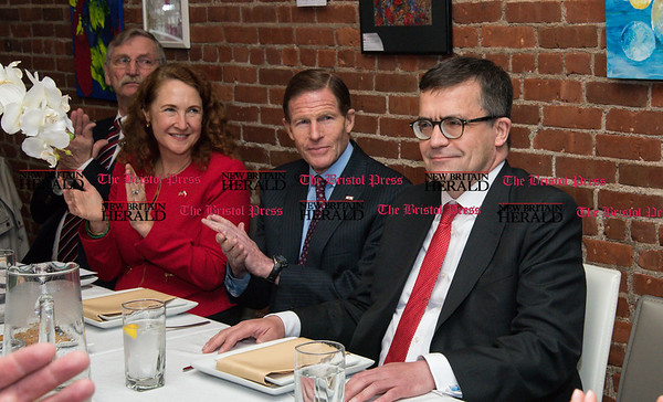 033117 Wesley Bunnell | Staff Polish Ambassador Piotr Wilczek visited New Britain's Little Poland section on Friday March 31, 2017 to celebrate the opening of an honorary Polish Consul in the city. From left, former Mayor Lucian Pawlak, Congresswoman Elizabeth Esty, Senator Richard Blumenthal applaud as Ambassador Piotr Wilczek is introduced during a luncheon at Belvedere Restaurant.