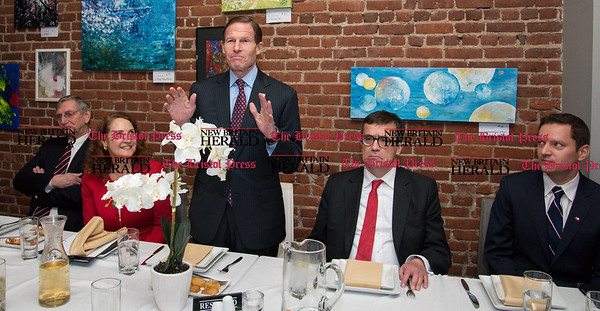 033117 Wesley Bunnell | Staff Polish Ambassador Piotr Wilczek visited New Britain's Little Poland section on Friday March 31, 2017 to celebrate the opening of an honorary Polish Consul in the city. Senator Richard Blumenthal, standing, speaks before a luncheon to welcome Polish Ambassador Piotr Wilczek. From left, former Mayor Lucian Pawlak, Congresswoman Elizabeth Esty, Ambassador Piotr Wilczek & honorary Consul Darek Barcikowski.