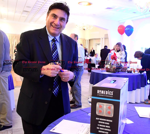 3/30/2017 Mike Orazzi | Staff David Zoni bids on silent auction items during the United Way of Southington's Annual Meeting held at the Aqua Turf Club in Southington Thursday night.