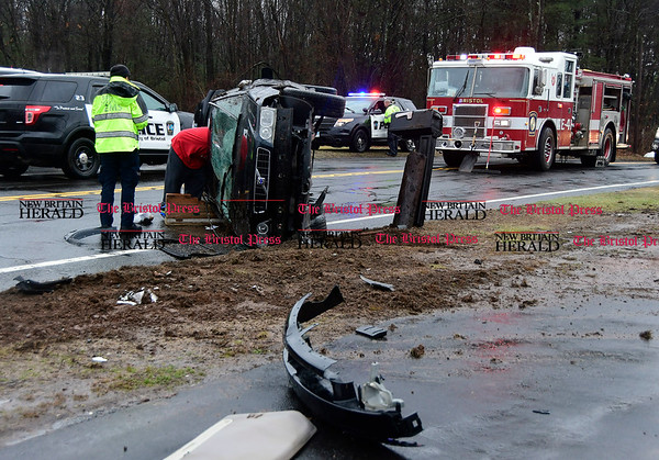 3/31/2017 Mike Orazzi | Staff The scene of a one car rollover crash on Redstone Hill in Bristol Friday afternoon. The driver was able to get out of the car and refused medical treatment.