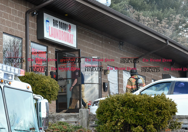 030317 Wesley Bunnell   Staff A fire official enters the Big Daddy 2 Laundromat on Friday March 3 after crews were finished with the fire.